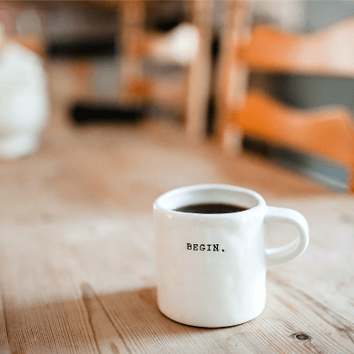 Picture of a cup of coffee with the word