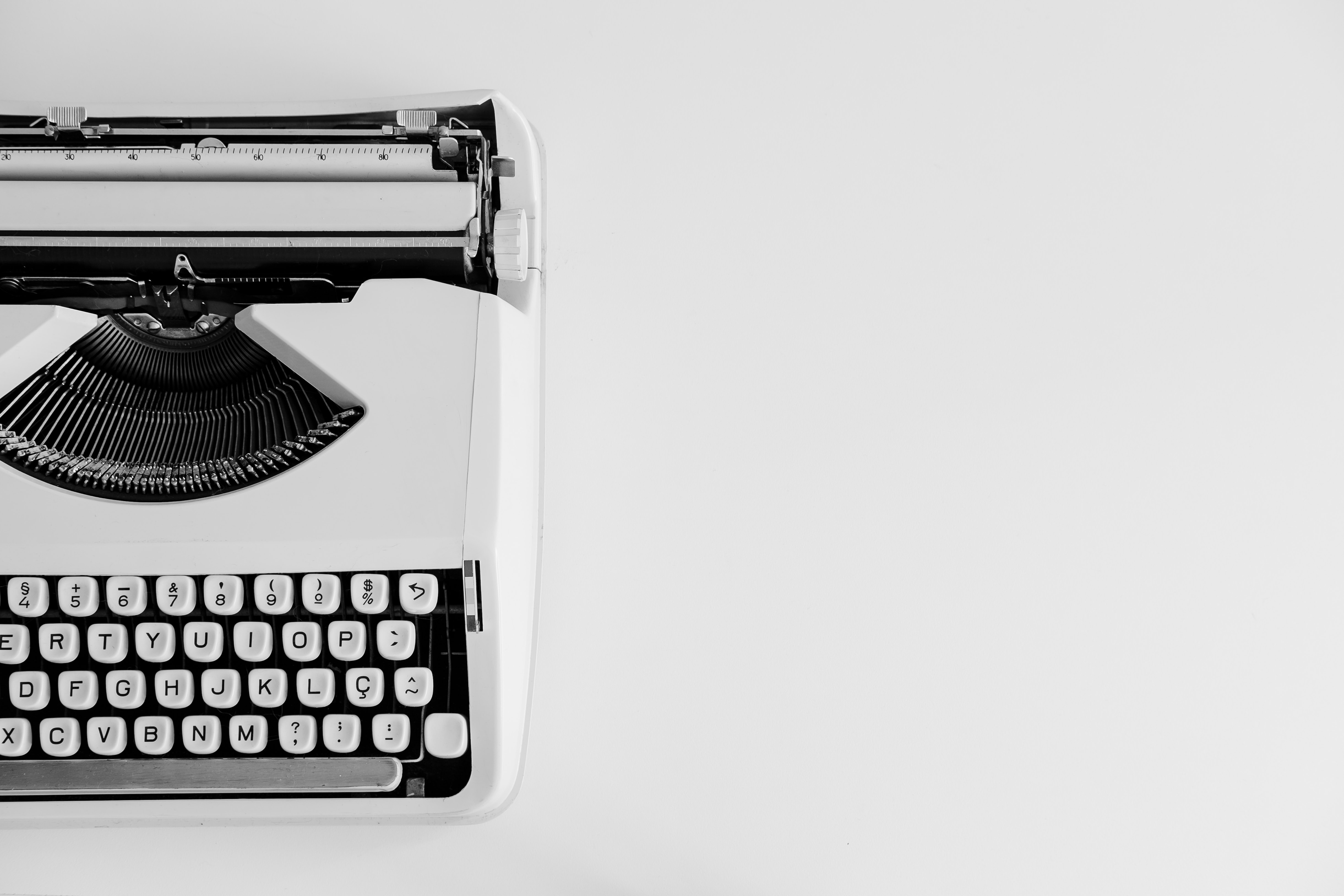 white typewriter on a white table top