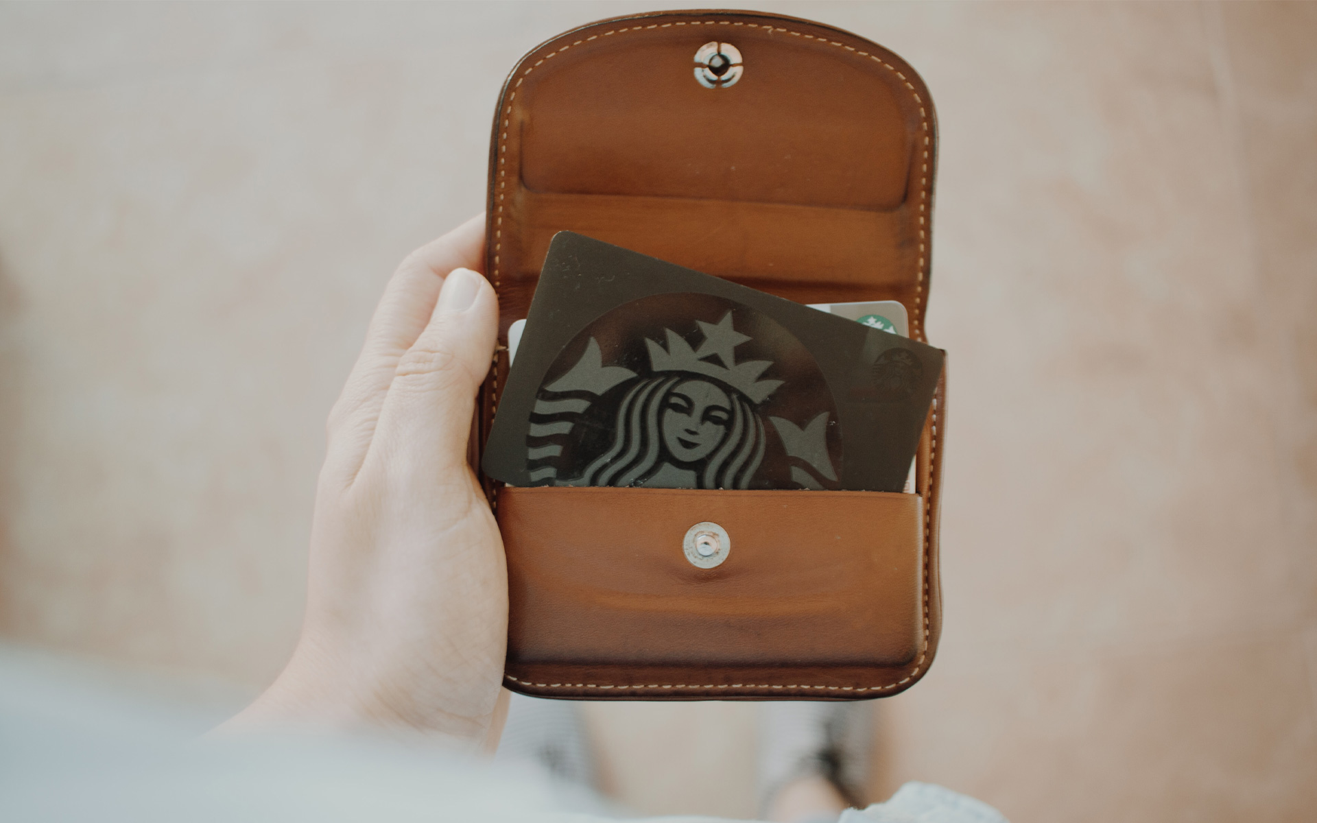 Starbucks customer loyalty card in a brown pouch